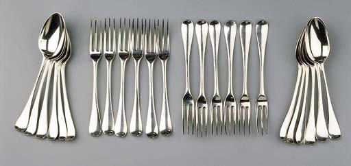 A set of twelve Dutch silver dessert forks and spoons and twelve table forks and spoons