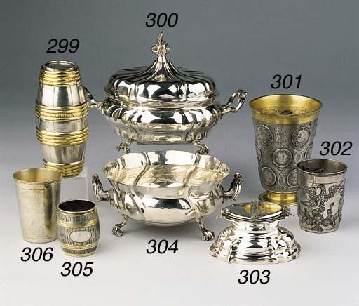 A parcel-gilt German silver double-beaker