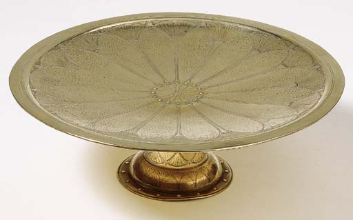 A hammered brass tazza