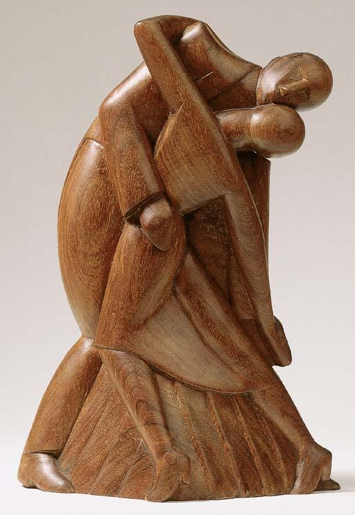 A wooden sculpture of a dancin