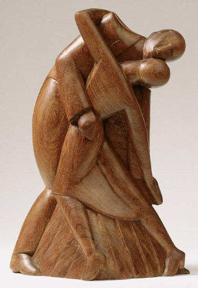 A wooden sculpture of a dancin