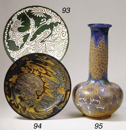 A glazed pottery wall-plate