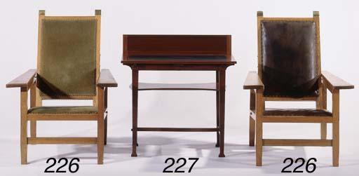 A carved mahogany writing-desk