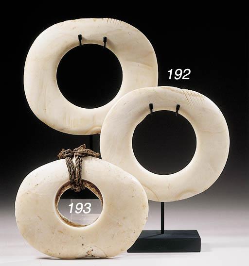 TWO MAPRIK SHELL RINGS