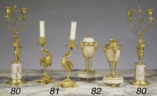 A pair of ormolu candlesticks