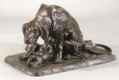 A bronze group of a hound with