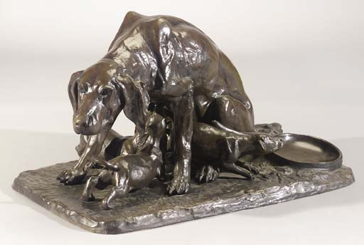 A bronze group of a hound with three puppies