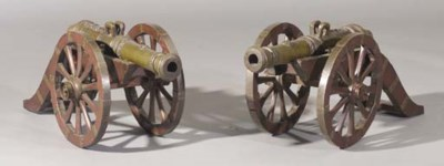 A pair of bronze miniature can