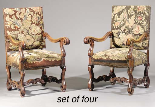 A set of four walnut fauteuils