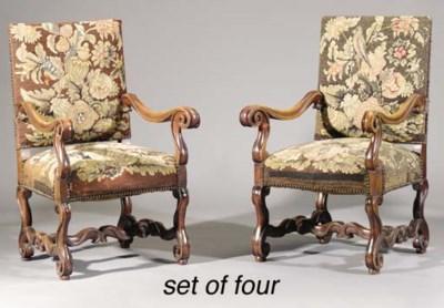 A set of four walnut fauteuils