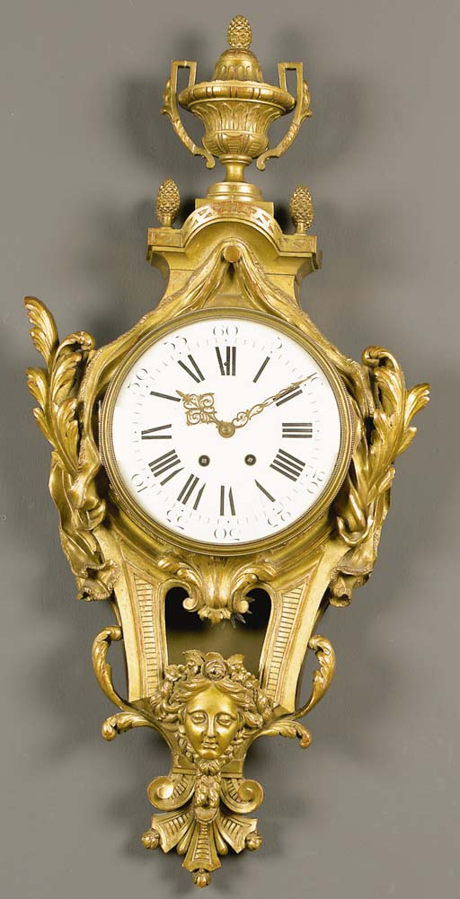 A French giltwood cartel clock