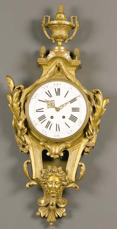 A French giltwood cartel clock