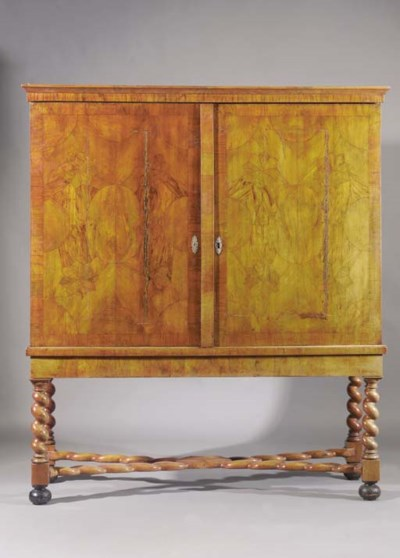 A Dutch walnut cabinet-on-stan