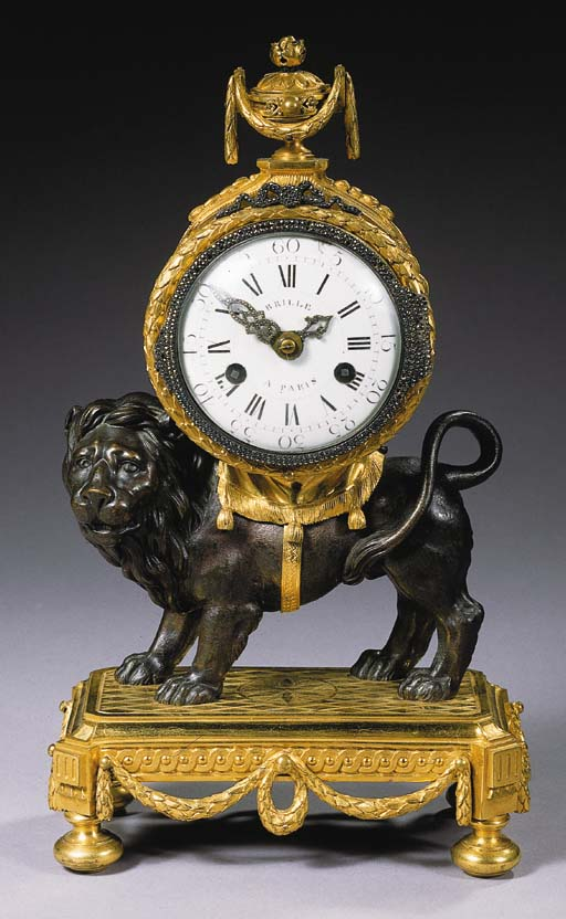 A Louis XVI ormolu and patinat