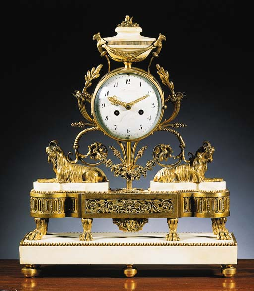 A Louis XVI ormolu and white-marble mantel clock