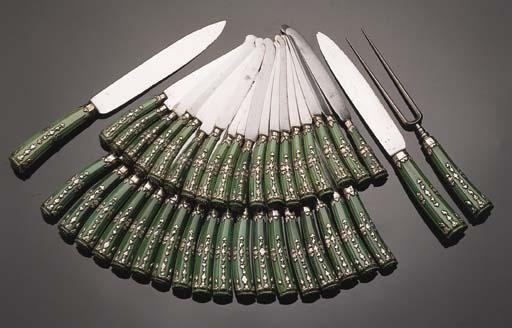 Eighteen table knives, ten des