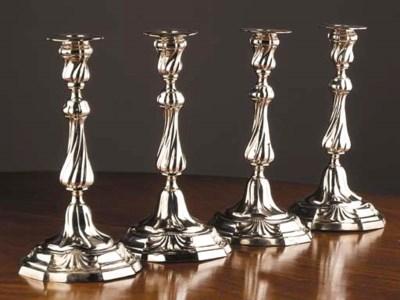 Four Dutch silver candlesticks