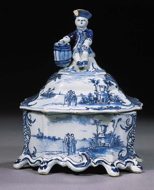 A Dutch Delft blue and white tobacco pot and cover