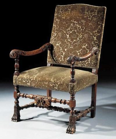 A Dutch walnut open armchair