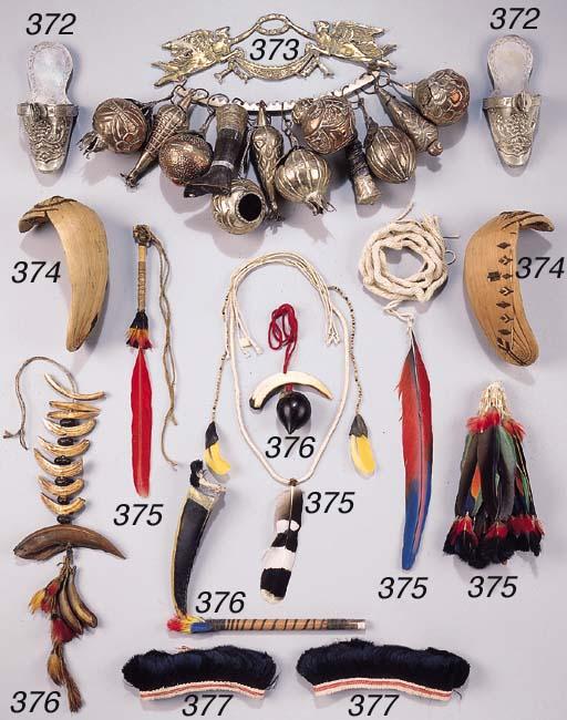 THREE AMAZONIAN ORNAMENTS