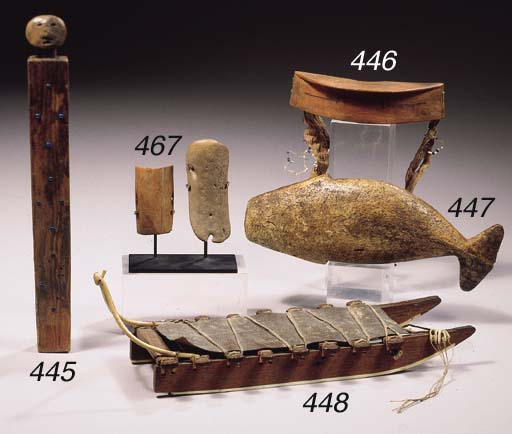 A FINE INUIT MODEL SLED AND A