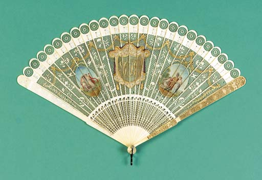 An ivory brise fan carved with inscription GP G[all]as