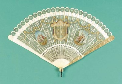 An ivory brise fan carved with