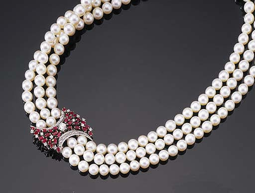 A THREE STRAND CULTURED PEARL NECKLACE WITH RUBY AND DIAMOND CLASP
