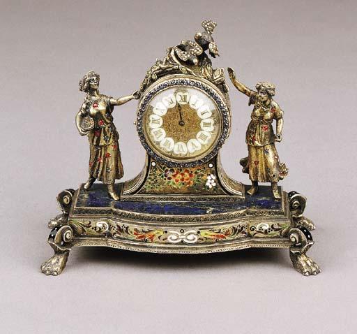 A parcel-gilt silver clock in original leather case