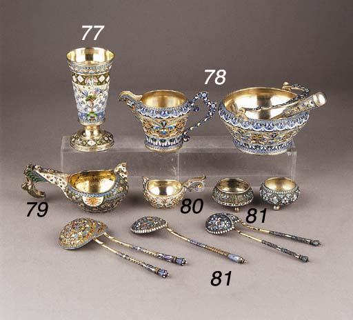 Five various Russian silver-gilt cloissonné enamel spoons and two salt-cellars