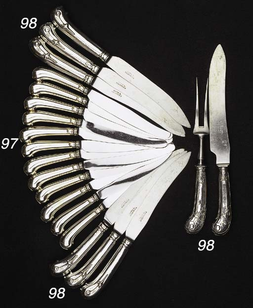 Six Dutch silver pistol handled knives, a carving fork and knife and an English silver hook