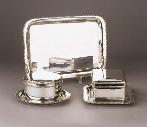 A set of two Dutch silver biscuit boxes with three various stands