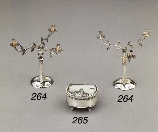 A pair of Dutch silver miniature three-light candelabra