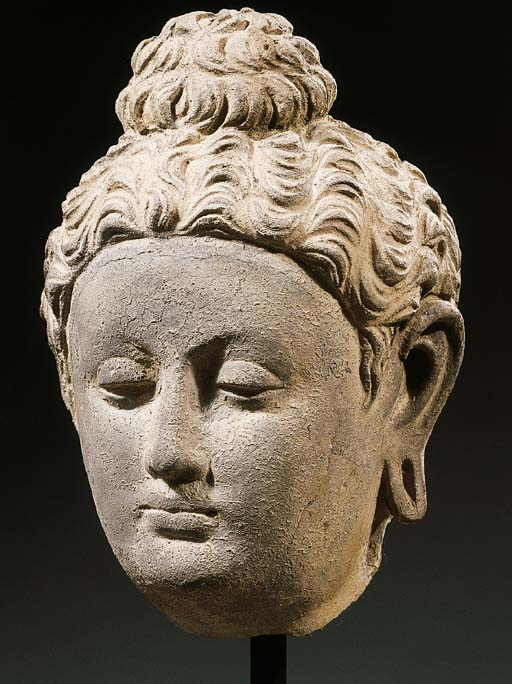 a gandhara terracotta head of