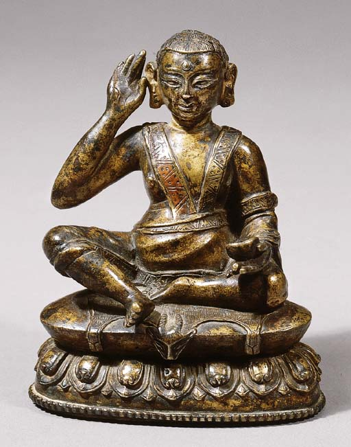 a tibetan bronze figure of mi.