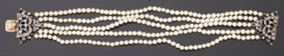A CULTURED PEARL BRACELET ON A