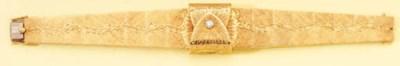 OMEGA. AN 18K GOLD AND DIAMOND