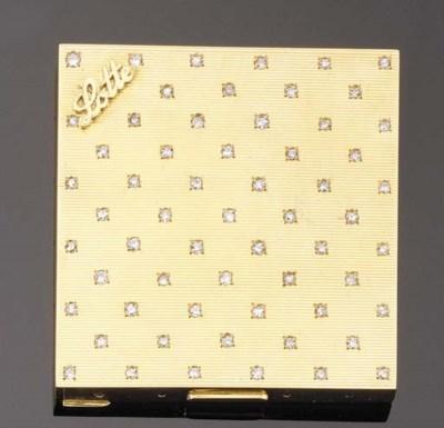 AN 18K GOLD AND DIAMOND POWDER
