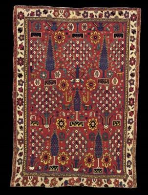 A NORTH WEST PERSIAN SHRUB RUG