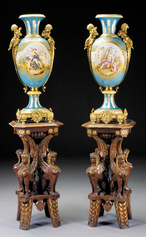 A pair of French ormolu-mounted parcel-gilt turquoise-ground Sèvres-pattern vases, on parcel-gilt carved walnut pedestals