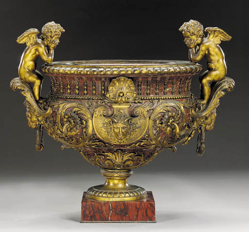A Napoleon III gilt-bronze and rouge griotte marble urn