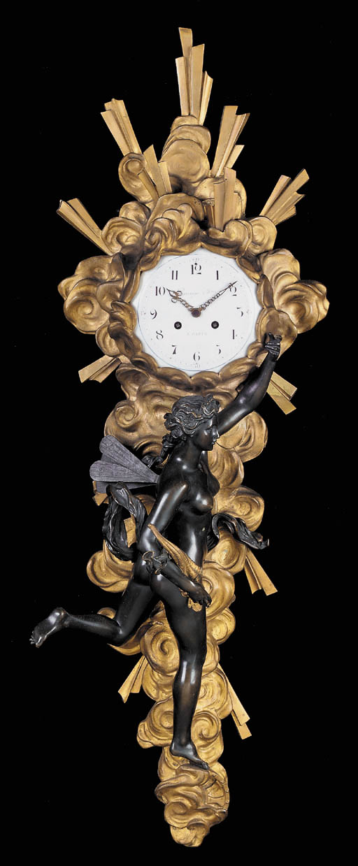 A Louis-Philippe gilt-  and patinated-bronze wall clock