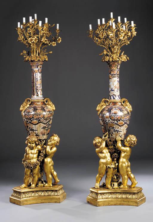 A large pair of Napoleon III ormolu-mounted Imari porcelain eleven-light candelabra, on giltwood bases