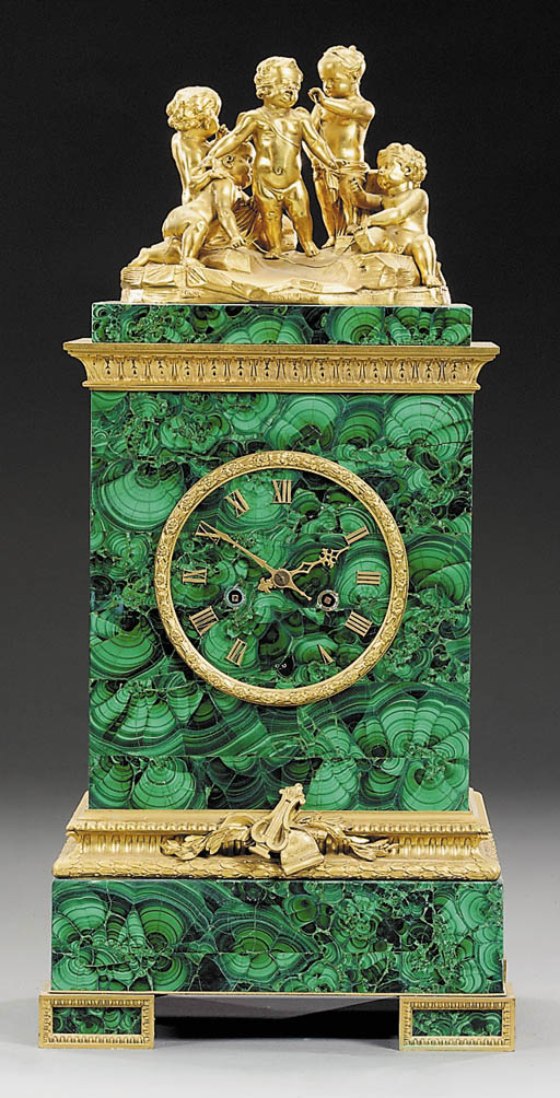 A Napoleon III gilt-bronze and malachite mantle clock