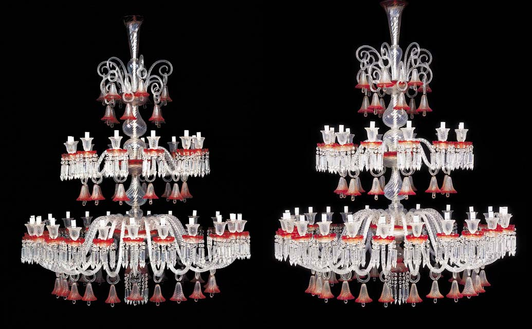A pair of thirty-six-light red and white glass chandeliers