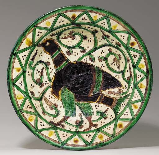 AN AGHKAND SGRAFFITO POTTERY D