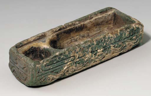 A CARVED GREEN STEATITE PENBOX