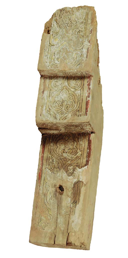 A PAINTED WOODEN CORBEL