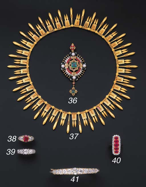 A ruby and diamond three-stone