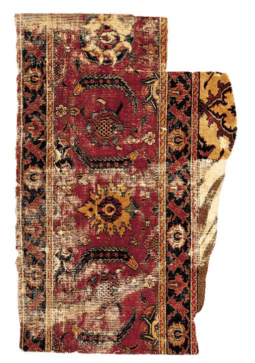 A KHORASSAN CARPET BORDER FRAG